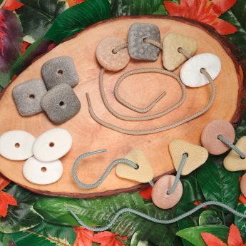 """16 stone pebbles: 4 shapes, textures and shades for sorting (approx. 1.5"""", plus two laces)"""